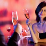 Amorous couple on romantic date or celebrating together at resta
